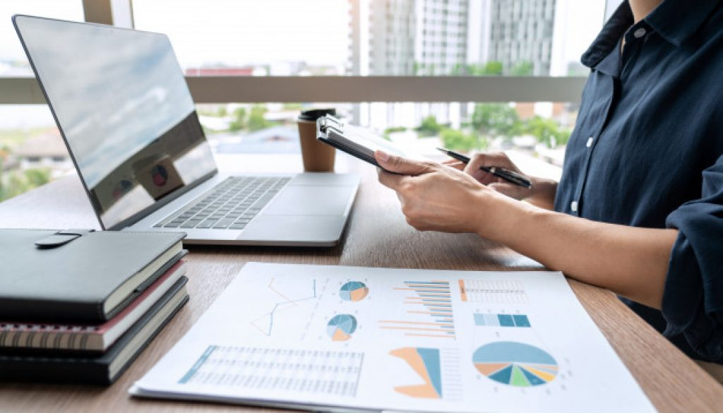 business-man-working-with-graph-data-laptop-documents-his-desk-office_1423-3412