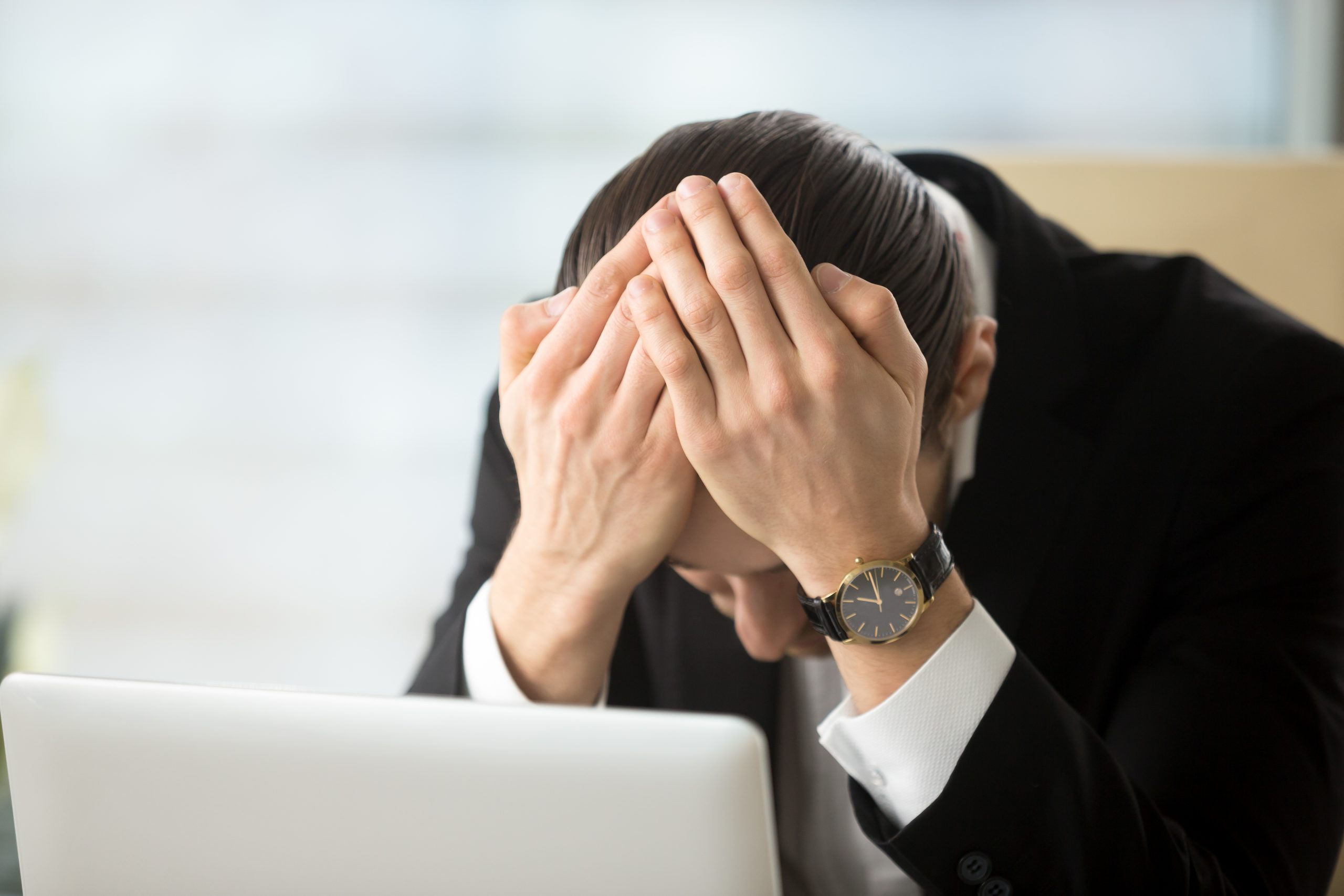 Businessman shocked because of company bankruptcy